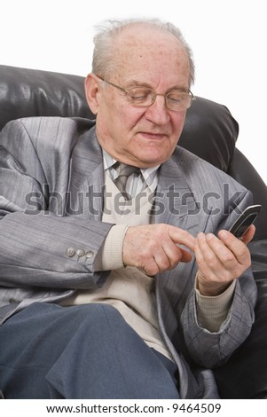 Close-up image of a senior man typing a message on his mobile phone. - stock photo