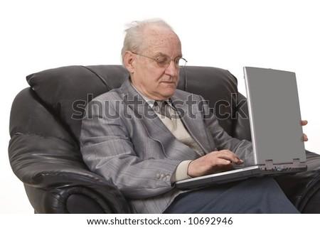 Close-up image of a senior man using a laptop. - stock photo
