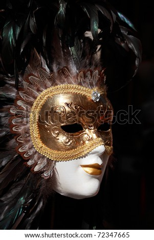 Close up image of a venetian mask on a souvenir shop stand in Venice,Italy. - stock photo
