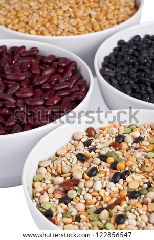 Close up image of assorted beans on white bowl against white background - stock photo