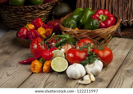 Close up image of assorted kinds of vegetable ingredients on wooden board - stock photo