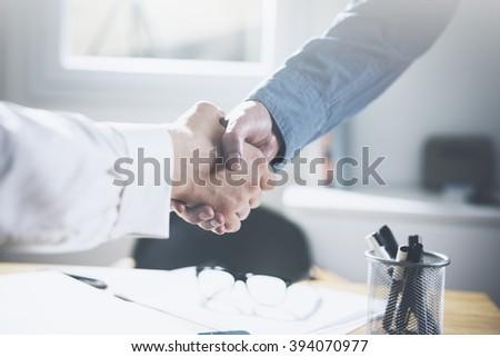 Close up image of business partners making handshake - stock photo