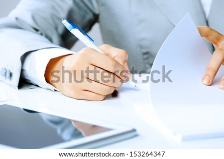Close up image of businesswoman hands signing documents - stock photo