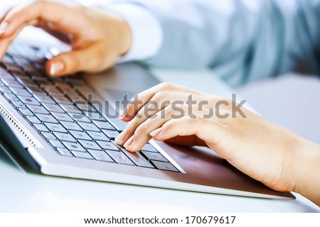 Close up image of businesswoman hands typing on keyboard - stock photo