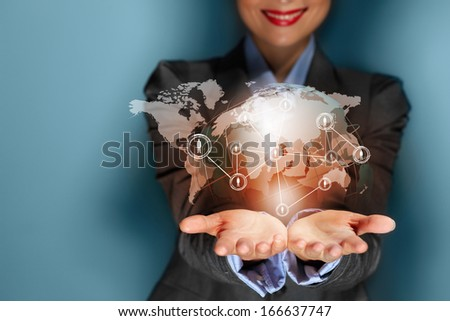 Close up image of businesswoman with 3d images of devices in her hands - stock photo