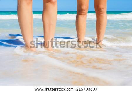 Close up image of couple enjoying the beach. - stock photo