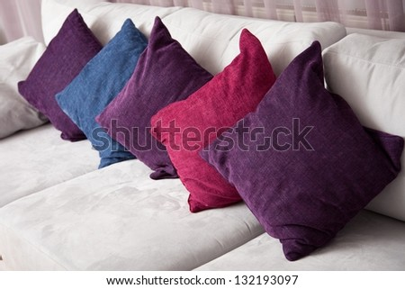 close up image of decorative colorful pillow on sofa - stock photo