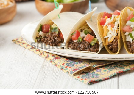 Close up image of delicious Mexican tacos on plate - stock photo