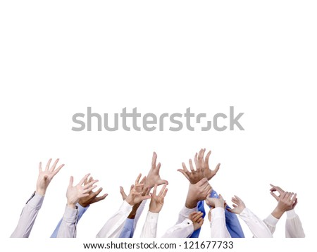 Close  up image of diverse hands reaching in the air against white background - stock photo
