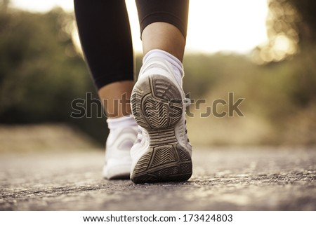 close up image of female fitness shoes during training in nature.  - stock photo