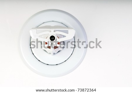 Close up image of fire sprinkler on white - stock photo