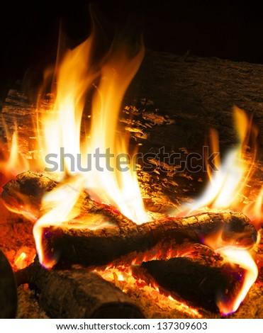 close up image of fireplace and wood burning - stock photo