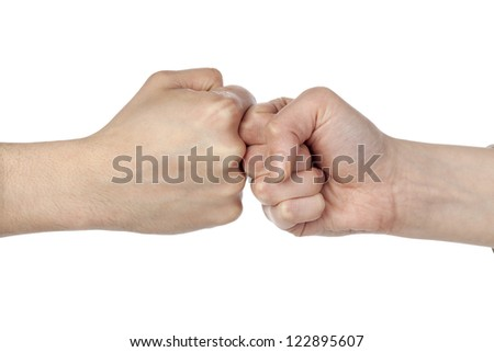 Close up image of fists bump against white background - stock photo