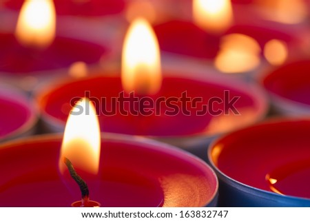 Close up image of glowing red tea lights - stock photo