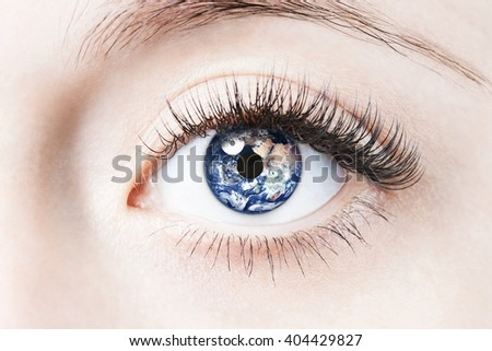 Close up image of human eye with earth in it. Elements of this image furnished by NASA - stock photo