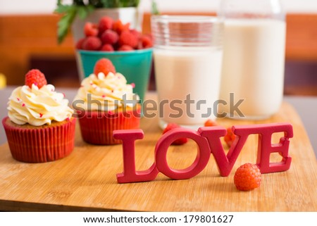 Close-up image of '??love'?� letters on the foreground, delicious breakfast on background  - stock photo