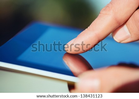 Close-up image of Man using digital tablet - stock photo