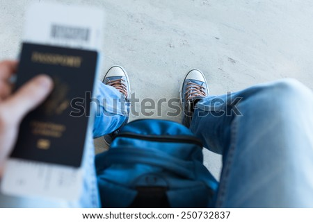 Close up image of man with passport - stock photo
