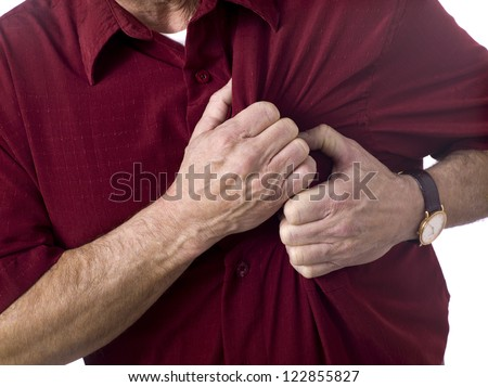 Close up image of old man having chess pain against white background - stock photo
