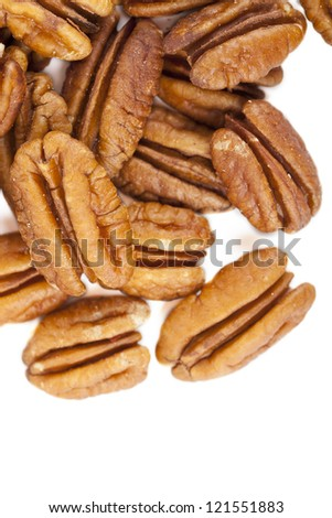 Close up image of pecan nuts against white background - stock photo