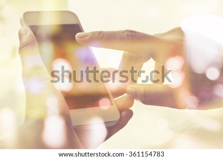 close up image of people using smart phone double exposure and blurred view of car on  street at night - stock photo