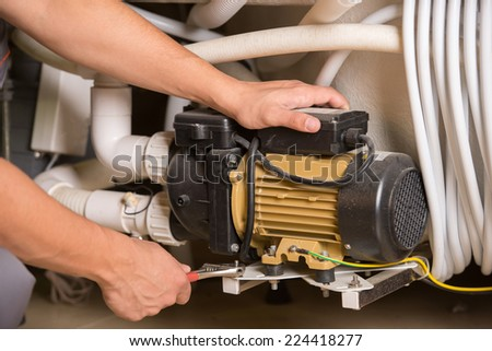 Close-up image of  plumber at work. - stock photo