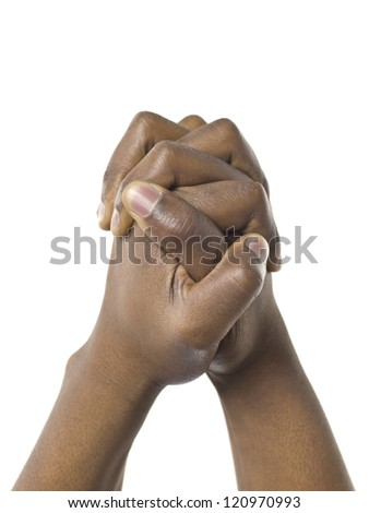 Close up image of praying hands against white background - stock photo