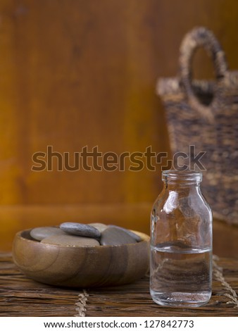 Close up image of spa essential oil and stone - stock photo