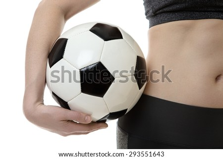 close up image of woman holding a soccer ball  - stock photo