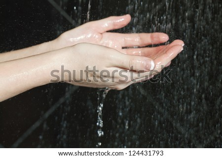 Close up image of woman washing her hands on the running water - stock photo