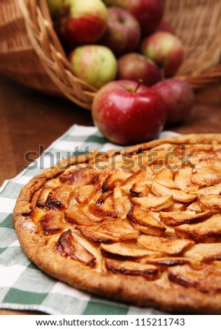 Close up image open apple pie on the wooden ta,le with fresh apples - stock photo