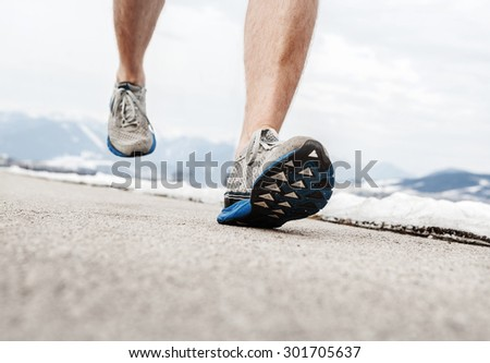 Close up image runner legs in running shoes - stock photo