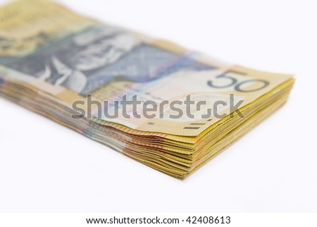 Close up image showing stack of Australian fifty dollar bills isolated on white - stock photo