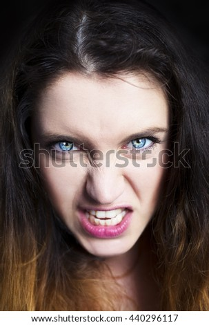Close up isolated portrait of young annoyed angry woman. Negative human emotions, face expressions.  - stock photo