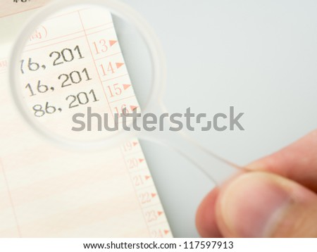 Close up Japanese bankbook with glasses - stock photo