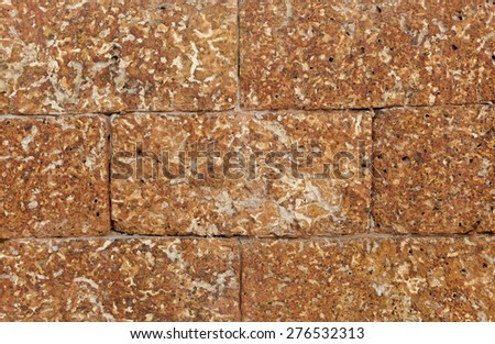 Close up  Laterite stone wall tiles texture,background - stock photo