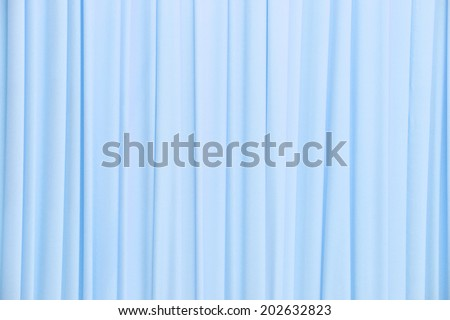 Close up light blue color curtain texture background - stock photo