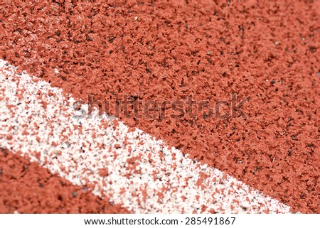 Close-up line on race track - stock photo