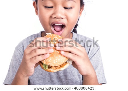Close up little Asian girl eating burger isolated on white background, Focus on hand - stock photo