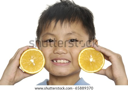 Close up little boy with an slice orange - stock photo