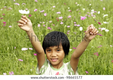 Close up little girl on the meadow in spring day - stock photo