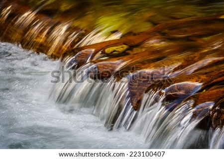 Close up little mountain waterfall - stock photo