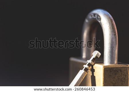Close up Lock with key on black background - stock photo