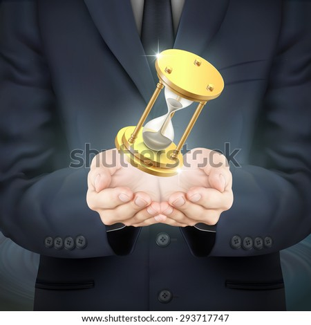 close-up look at businessman holding a hourglass  - stock photo