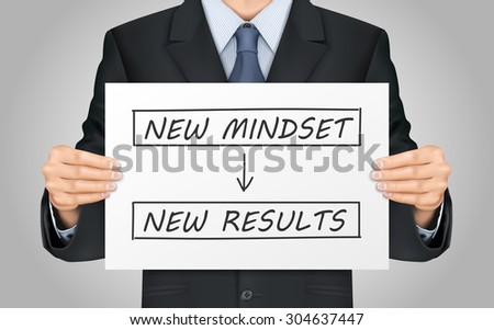 close-up look at businessman holding new mindset make new results poster - stock photo