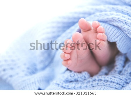 Close up look of a pair of asian baby's foot - stock photo