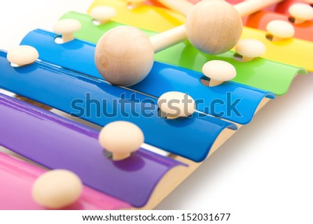 close up look of colorful xylophone and sticks - stock photo