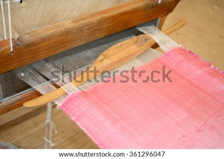 Close up Loom weaving silk pink  in thailand  - stock photo