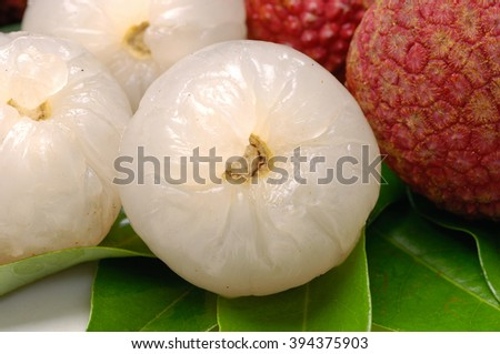 Close up lychee and peeled lychee  - stock photo