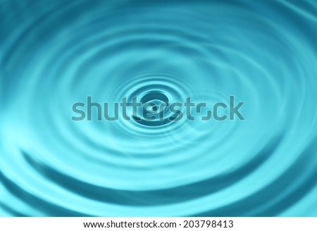 Close-up macro of a wave from water drop droplet - stock photo